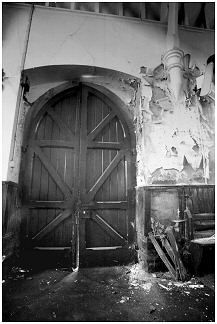 The strong wooden door of the chapel