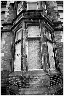 BOARDED UP WINDOW BAY