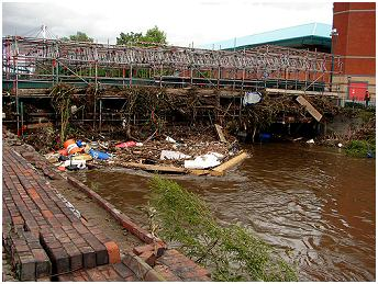 Footbridge covered in debris from the mad floods